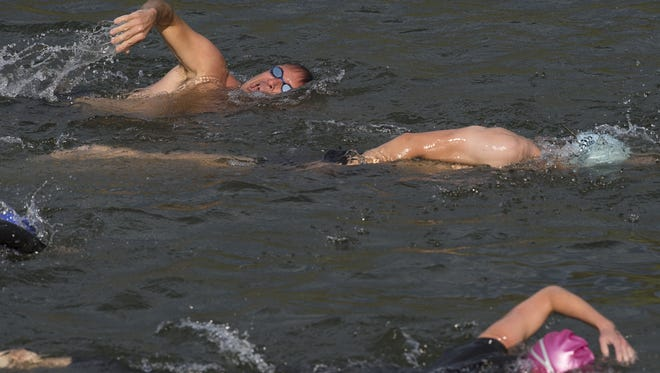 Athletes swim along the south beach of Horsetooth Reservoir Wednesday, August 3, 2016. Green Events is hosting the Horsetooth Tri Training Series so athletes can train for upcoming events.