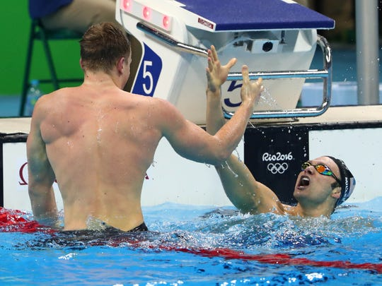 Adam Peaty (GBR) with Cody Miller (USA) after the men's 100m breaststroke final in the Rio 2016 Summer Olympic Games at Olympic Aquatics Stadium.