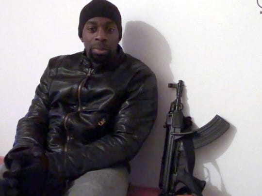 This screengrab taken on Jan. 11 from a video released on Islamist social networks shows a man claiming to be Amedy Coulibaly, who is suspected of killing a policewoman in Paris on Jan. 8 and four hostages after seizing a Kosher supermarket on Jan. 9.