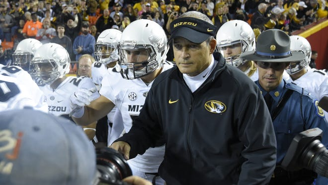 Missouri coach Gary Pinkel leads his team onto the field prior to a game against the Brigham Young Cougars at Arrowhead Stadium on Saturday.