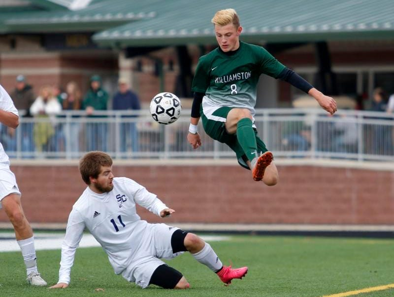 Williamston's Brian Ganton (8) and Grand Rapids South Christian's Matt VanderHill (11) battle during the MHSAA Division 3 Championship game Saturday, Nov. 7, 2015, in Comstock Park, Mich. After playing to a scoreless tie through overtime, Williamston fell in a shootout.