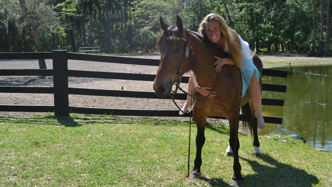 Sophie Lindhe helps rehab horses at Brevard's Wild Horse Rescue Center in Mims.