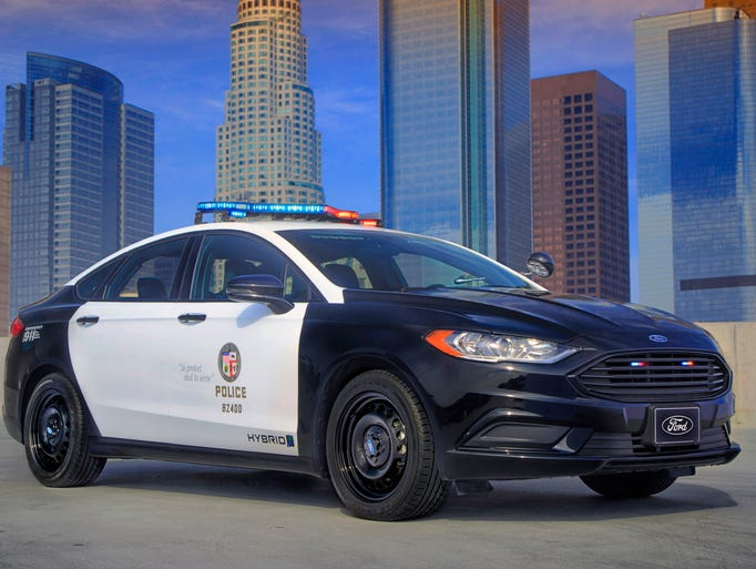 photos ford 39 s new hybrid police car gets tough on gas mileage. Black Bedroom Furniture Sets. Home Design Ideas