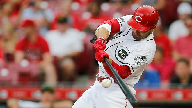 Cincinnati Reds first baseman Joey Votto (19) swings as he flies out to left field in the bottom of the first inning of an MLB National League game between the Cincinnati Reds and the Arizona Diamondbacks at Great American Ball Park in downtown Cincinnati on Friday, Aug. 10, 2018.