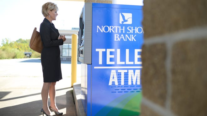 Sue Doyle, a senior vice president with North Shore Bank, demonstrates their new drive-thru video teller machine at the Howard location on Tuesday.