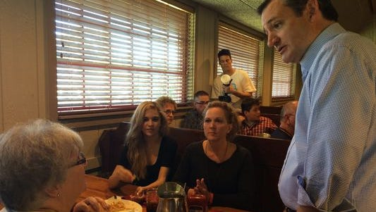 Texas Sen. Ted Cruz visits the table of Cherly Hetrick, 49, of Des Moines (middle) and talks about his recent CNN debate performance.