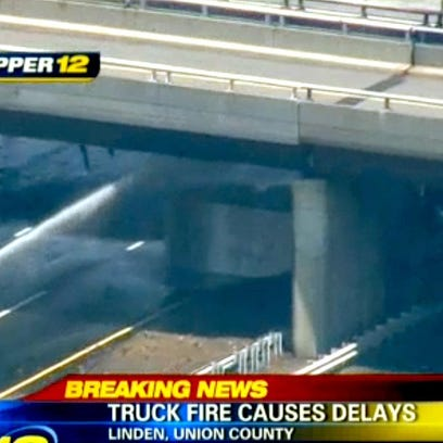 An overturned truck on the NJ Turnpike is shown under