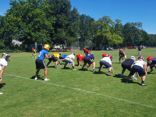 The Lions North football team practices at Shasta College.