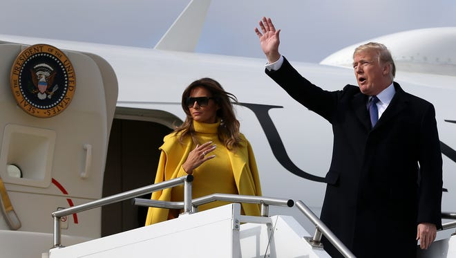 U.S. President Donald Trump and first lady Melania Trump land at Lunken Airport, Monday, Feb. 5, 2018, in Cincinnati.