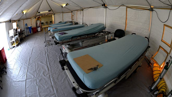 The Regional Medical Center of San Jose sets-up a 'flu tent' outside an emergency room to treat patients with flu-like symptoms in San Jose, Calif., on Jan. 11, 2014. The California's State health director has declared that influenza has gained ground throughout the state.