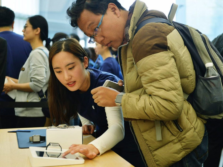 An Apple employee shows off the Apple Watch at a new store in Hangzhou, China.