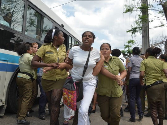 Cuban policewomen remove dissidents in Havana on March