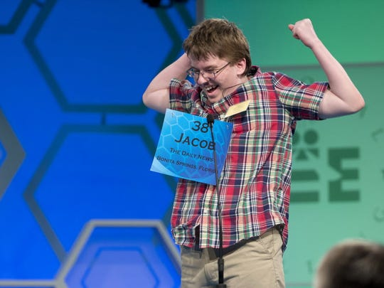 """n this May 29, 2014 file photo, Jacob Williamson of Cape Coral, Fla., reacts after correctly spelling his word """"harlequinade"""", during the semifinals of the Scripps National Spelling Bee at National Harbor in Oxon Hill, Md. The Scripps National Spelling Bee has a profound influence on the lives of many young people who participate."""