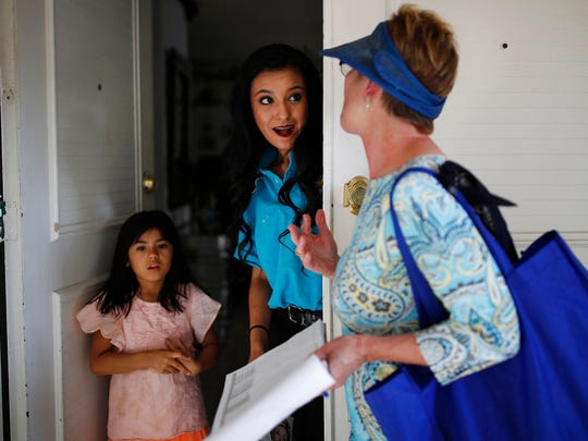 In this June 6, 2018, photo, Clark County Commission member Chris Giunchigliani, right, speaks with Susan Garcia, center, and Aileen Vides while campaigning in Las Vegas. The fiercest primary election battle in Nevada this year is a race between two Democrats vying to become the swing state's first Democratic governor in almost two decades. The fight between longtime Clark County Commissioners Steve Sisolak and Giunchigliani has seen them spar over their response to the October mass shooting in Las Vegas while pledging to resist President Donald Trump and the National Rifle Association.