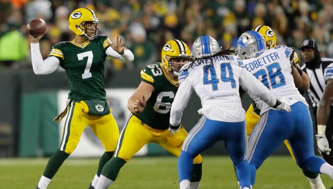 Green Bay Packers quarterback Brett Hundley (7) throws as center Corey Linsley (63) blocks against the Detroit Lions Monday, November 6, 2017, at Lambeau Field in Green Bay, Wis.