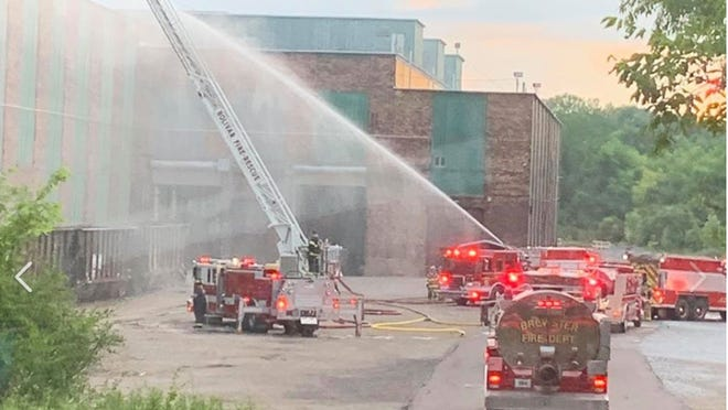 Firefighters from multiple departments joined the Brewster Fire Department Thursday evening, battling a large commercial blaze at the Wheeling & Lake Erie Railway Co. grounds. Damage to the building is expected to run between $2 million and $3 million.