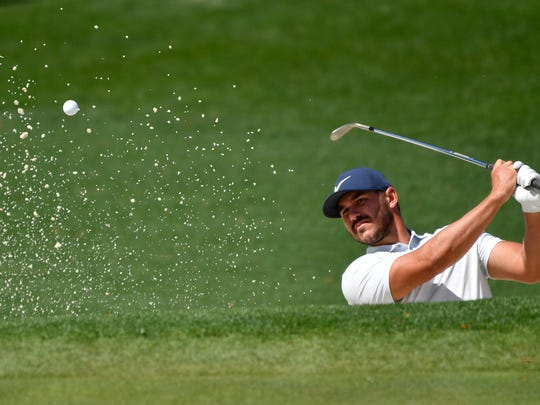 Apr 9, 2019; Augusta, GA, USA; Brooks Koepka hits from the sand at the second green during a practice round for The Masters golf tournament at Augusta National Golf Club. Mandatory Credit: Michael Madrid-USA TODAY Sports