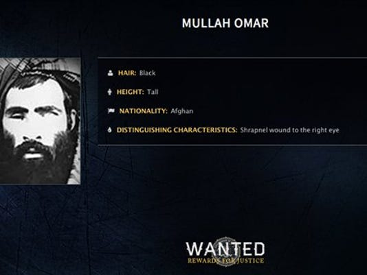 In this undated image released by the FBI, Mullah Omar is seen in a wanted poster. An Afghan official says his government is examining claims that reclusive Taliban leader Mullah Omar is dead. The Taliban could not be immediately reached for comment on the government's comments about Omar, who has been declared dead many times before.