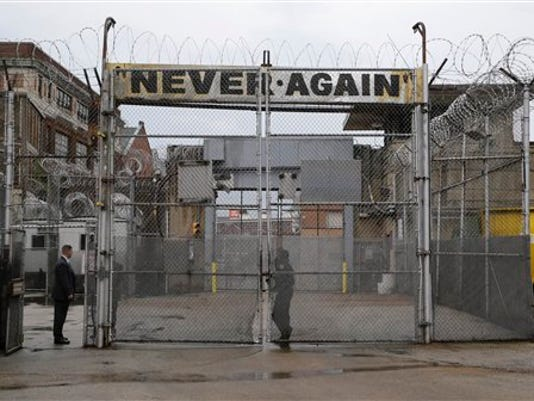 A sign stands above a gate at Baltimore City Detention Center. The jail grabbed headlines in 2013 after a sweeping federal indictment exposed a sophisticated drug- and cellphone-smuggling ring involving dozens of gang members and correctional officers.