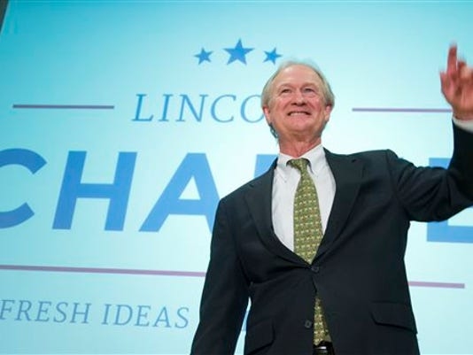 Former Rhode Island Gov. Lincoln Chafee, waves after announcing his candidacy for the Democratic presidential nomination during a speech at George Mason University in Arlington, Va., Wednesday, June 3, 2015. Chafee entered the race Wednesday, casting himself as an anti-war candidate who opposed the invasion of Iraq back when Hillary Rodham Clinton supported it.