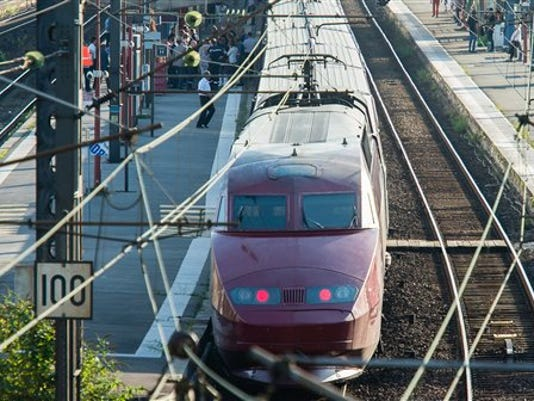 A Thalys train of French national railway operator, SNCF, stands at the main train station in Arras, northern France, after a gunman opened fire injuring three people, Friday, Aug. 21, 2015. A spokesman for France's interior ministry says three people were wounded in a shooting on a high-speed train traveling from Amsterdam to Paris Friday. Speaking on French television BFM, Pierre-Henri Brandet says a suspect is in custody and the train has been evacuated in Arras, 115 miles (185 kilometers) north of Paris, where the train stopped after the attack.
