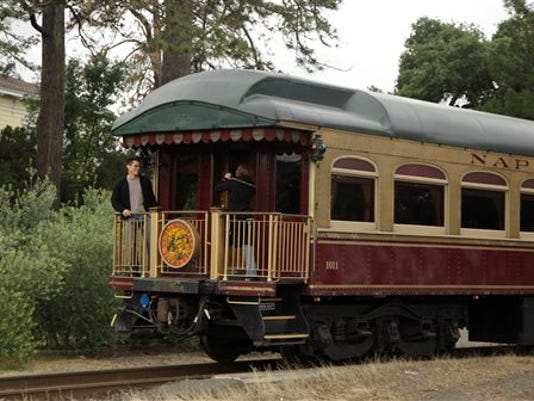 FILE - In this June 2, 2011 file photo, a couple takes pictures at the back of the Napa Valley Wine Train as it makes its way through St. Helena, Calif. Members of a mostly black book club say they believe they were kicked off the train because of their race. The women say they were ordered off the wine train Saturday, Aug. 22, 2015. Book club member Lisa Renee Johnson said that employees told the women they were laughing and talking too loudly.