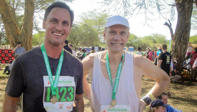 Jim Koenigsaecker poses with Robert Godec, the U.S. ambassador to Kenya, after they both participated in the Lewa Marathon in Kenya in 2017.