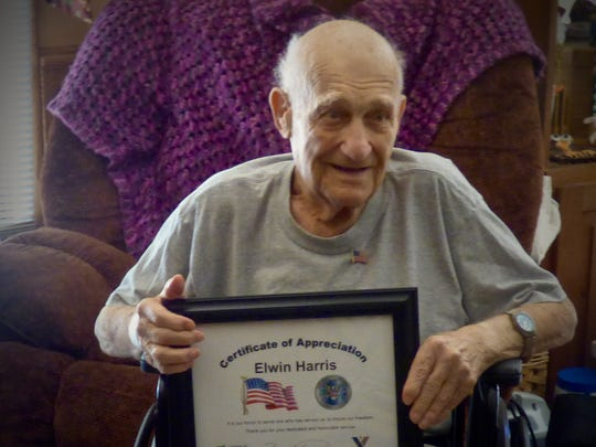 A pinning ceremony in July honored Elwin Harris, 98,