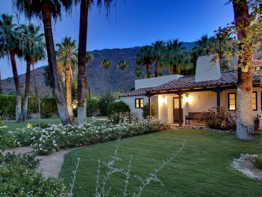 This Spanish hacienda home in Old Las Palmas draws from tradition, with original beamed ceilings and tile work.
