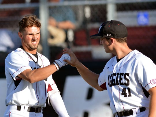 The Aggies L.J. Hatch (left) gets congratulated by teammate  Austin Bryan after hitting a two run homer in the bottom of the first inning against Cal State Bakersfield on Thursday night.