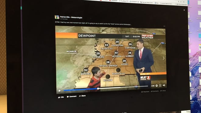 In this photo of a Facebook post, a kid runs onto the set in the  middle of a live weather report WLBT meteorologist Patrick Ellis.