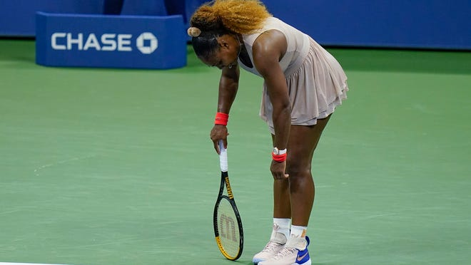 Serena Williams, of the United States, reacts during a semifinal match of the US Open tennis championships against Victoria Azarenka, of Belarus, Thursday, Sept. 10, 2020, in New York.