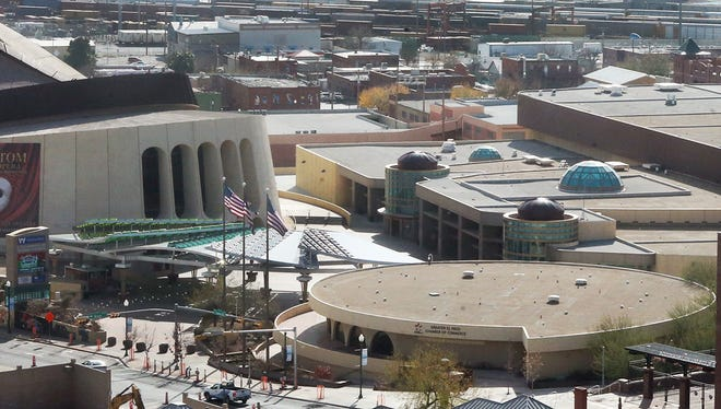 Construction has started on the new Downtown Marriott hotel, but owner Jim Scherr is concerned that $4.4 million in state rebates might be at risk because the city is considering the convention center site for a $180 million arena. The possible impact on future conventions also has sparked concern.