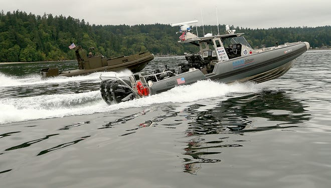 A pair of SAFE Boats piloted by WIll Coco and Jim Bankson cruise through the Port Washington Narrows.