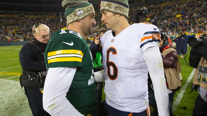 Nov 9, 2014; Green Bay, WI, USA; Green Bay Packers quarterback Aaron Rodgers (12) talks with Chicago Bears quarterback Jay Cutler (6) following the game at Lambeau Field.  Green Bay won 55-14.  Mandatory Credit: Jeff Hanisch-USA TODAY Sports ORG XMIT: USATSI-180302 ORIG FILE ID:  20141109_jla_sh5_296.jpg
