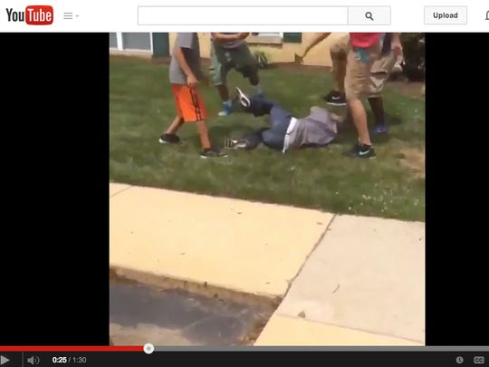 An image from the YouTube video of attacks on a mentally challenged man is shown. Two teens have been charged and police expect more arrests in the case.