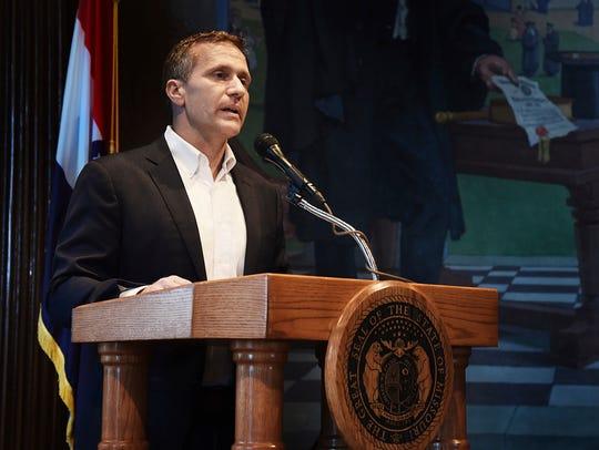 Missouri Gov. Eric Greitens reads from a prepared statement