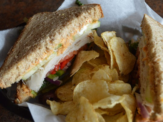 The Mediterranean dreams sandwich is made with turkey, Greek yogurt, red pepper hummus, cucumber, red onions, tomato, mixed greens and Kalamata olives on whole grain artisan wheat bread. It's served with kettle chips for $8.99.