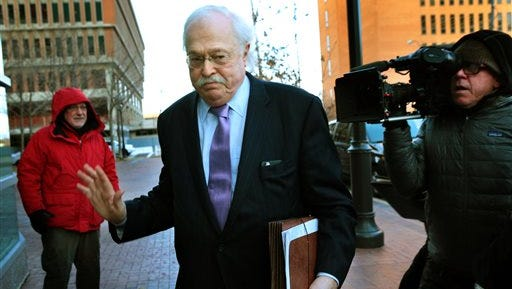 Pathologist Dr. Michael Baden waves off media questions as he arrives to testify before the grand jury concerning the Michael Brown shooting at the Buzz Westfall Justice Center in Clayton, Mo., on Thursday, Nov. 13, 2014. Attorneys for the family of Michael Brown are urging restraint by both protesters and police once a grand jury decides whether the suburban St. Louis officer who shot him should face charges. (AP Photo/St. Louis Post-Dispatch, Robert Cohen)  EDWARDSVILLE INTELLIGENCER OUT; THE ALTON TELEGRAPH OUT