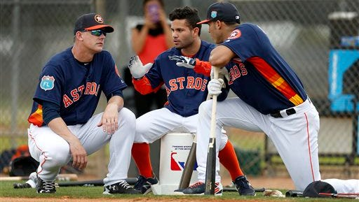 In this Feb. 23, 2016, file photo, Houston Astros manager A.J. Hinch, left, and Astros' Jose Altuve and Carlos Correa chat during a workout at the Astros spring training camp in Kissimmee, Fla. Altuve is one of only a handful of remaining Astros who endured the team's rebuilding project.