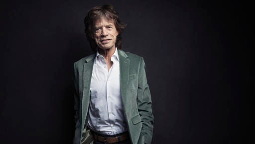 Mick Jagger of the Rolling Stones poses for a portrait on Monday, Nov. 14, 2016, in New York. Jagger was coming up with ideas for an exhibition highlighting The Rolling Stones' five-decade long career, he wanted to re-create the mood of the band in their early years. So, he had a team re-make the first - and messy - London apartment he shared with his band mates in 1962, complete with dirty dishes, beer bottles and blues records placed throughout the flat.
