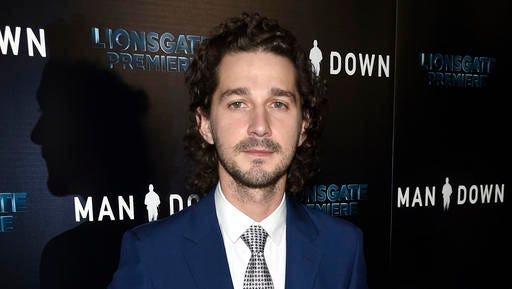 "FILE - This Nov. 30, 2016 file photo shows Shia LaBeouf at the premiere of ""Man Down"" in Los Angeles. LaBeouf led a group of teenagers with the chant: ""He will not divide us."" Looking into a camera placed on a wall outside the Museum of the Moving Image in New York, a diverse group of teenagers chanted the words on the day Donald Trump was named president in Washington, D.C."