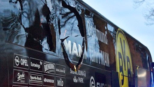 FILE - In this April 11, 2017 file photo a window of Dortmund's team bus is damaged after an explosion before the Champions League quarterfinal soccer match between Borussia Dortmund and AS Monaco in Dortmund, western Germany.