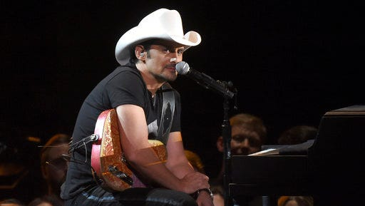 "FILE - In this Nov. 2, 2016 file photo, Brad Paisley performs at the 50th annual CMA Awards in Nashville, Tenn. Paisley's newest album, ""Love and War,"" was released this month."