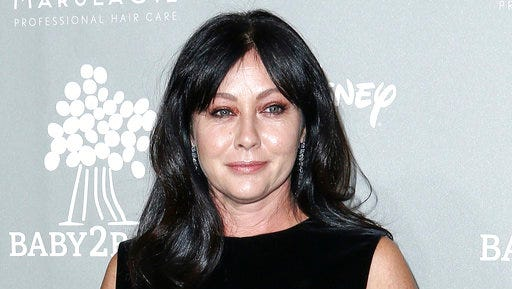 FILE - In this Nov. 14, 2015 file photo, Shannen Doherty attends the 4th Annual Baby2Baby Gala in Culver City, Calif. Doherty wrote on Instagram April 28, 2017, that her breast cancer is in remission.