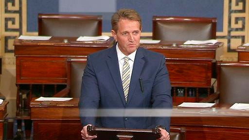 """In this image from video from Senate Television, Sen. Jeff Flake, R-Ariz. speaks on the Senate floor, Jan. 17, 2017, at the Capitol in Washington. Flake called Trump's repeated attacks on the media """"shameful"""" and """"repulsive."""""""