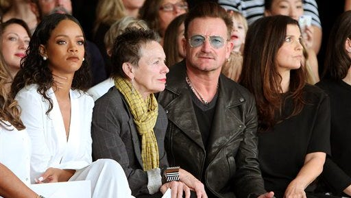 In this image released by Starpix, Rihanna, from left, Laurie Anderson, Bono and Ali Hewson sit in the front row at the Edun Spring 2015 collection, Sunday during Fashion Week in New York.