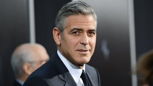 "Actor George Clooney attends the premiere of ""Gravity"" at the AMC Lincoln Square Theaters, in New York. The Hollywood Foreign Press Association announced on the Golden Globe Awards website that Clooney will be the next recipient of the Cecil B. DeMille Award. The Golden Globe Awards will be held on Jan. 11, 2015."
