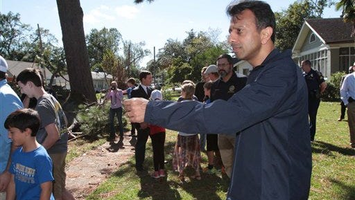 Gov. Bobby Jindal tours storm damage in the Garden District in Monroe,  on Tuesday, Oct. 14, 2014. Jindal flew into the Twin Cities to inspect the area after declaring a state of emergency following Monday's storm.