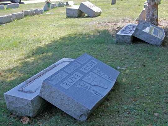 Dozens of gravestones have been pushed over at St. Peter and Paul's Cemetery.